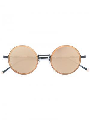 Солнцезащитные очки в круглой оправе Matsuda. Цвет: телесный