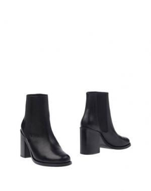 Полусапоги и высокие ботинки FOLK. Цвет: черный