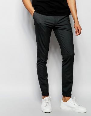 ASOS Супероблегающие спортивные брюки. Цвет: серый