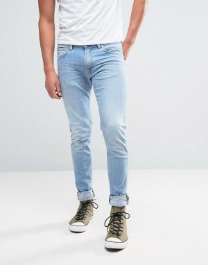 Edwin Суженные книзу джинсы с эффектом поношенности и заниженным шаговым шво. Цвет: синий