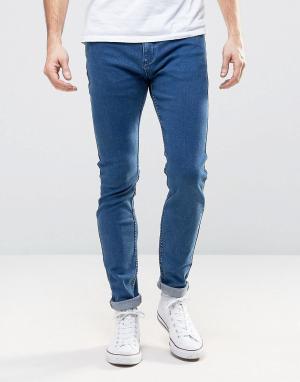 Rollas Супероблегающие джинсы с заниженной талией Stinger. Цвет: синий