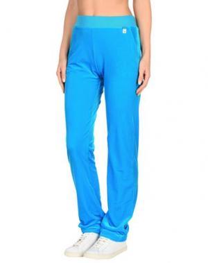 Пляжные брюки и шорты VERSACE. Цвет: бирюзовый