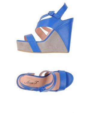 Сандалии ANNA F.. Цвет: синий