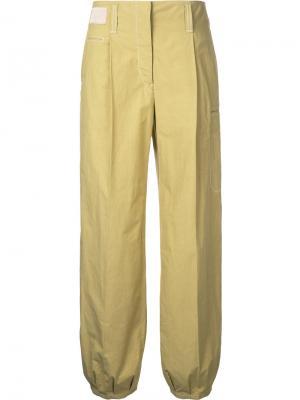 Расклешенные брюки Lemaire. Цвет: жёлтый и оранжевый