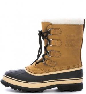 Высокие непромокаемые ботинки из нубука и резины Sorel. Цвет: коричневый