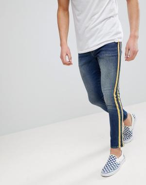 ASOS Выбеленные супероблегающие джинсы с желтыми полосками. Цвет: синий