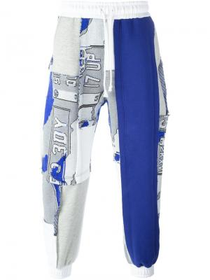 Спортивные брюки лоскутного кроя Liam Hodges. Цвет: белый