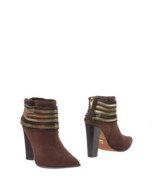 Полусапоги и высокие ботинки CARRANO. Цвет: темно-коричневый