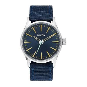 Часы  Sentry 38 Nylon Navy/Brass Nixon. Цвет: серый,синий
