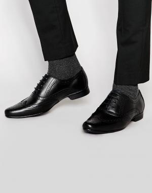 Front Черные кожаные броги. Цвет: черный