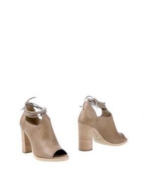 Полусапоги и высокие ботинки UNLACE. Цвет: хаки