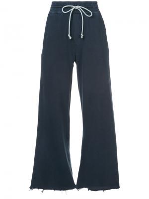 Расклешенные спортивные брюки Mother. Цвет: синий