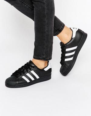Adidas Черные кроссовки с белыми полосами Originals Superstar. Цвет: белый