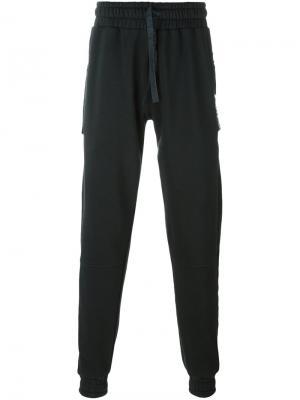 Спортивные брюки с карманами на молнии Blood Brother. Цвет: серый