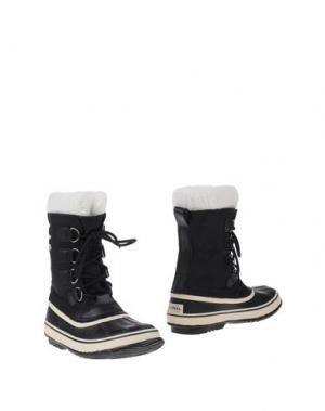 Полусапоги и высокие ботинки SOREL. Цвет: черный