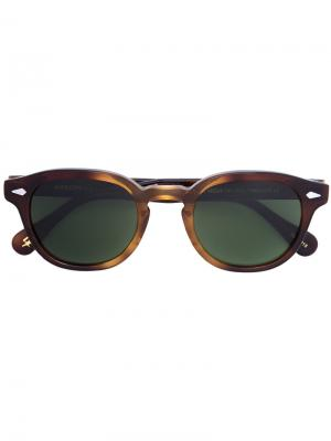 Солнцезащитные очки в круглой оправе Moscot. Цвет: коричневый