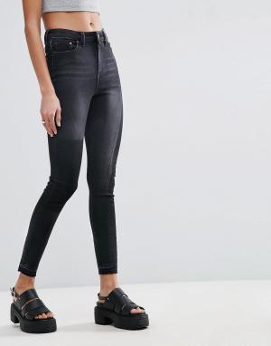 ASOS Черные выбеленные джинсы скинни с рваной отделкой RIDLEY. Цвет: черный