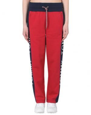 Повседневные брюки TOMMY JEANS. Цвет: красный