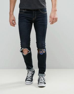 Always Rare Темные суперузкие джинсы с рваной коленкой и заплатками De. Цвет: темно-синий