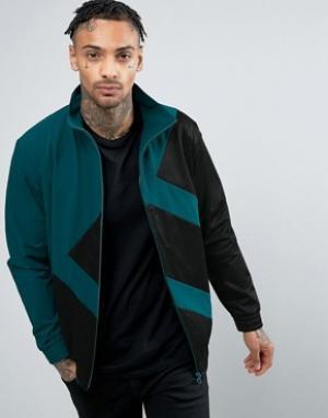 Adidas Originals Зеленая спортивная куртка Berlin BK7209. Цвет: зеленый