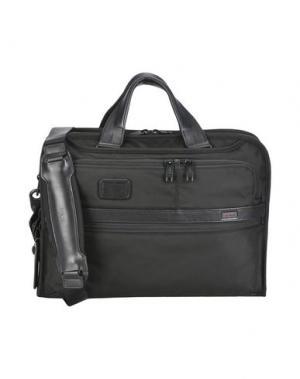 Деловые сумки TUMI. Цвет: черный