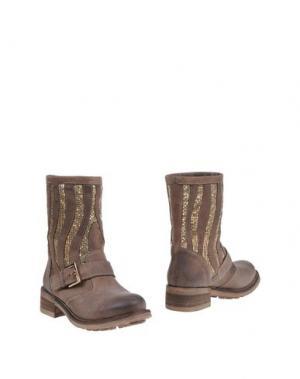 Полусапоги и высокие ботинки FABBRICA MORICHETTI. Цвет: хаки