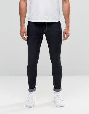 Antioch Зауженные джинсы цвета индиго с покрытием. Цвет: синий