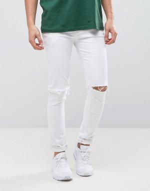 ASOS Белые супероблегающие джинсы с рваными коленями. Цвет: белый
