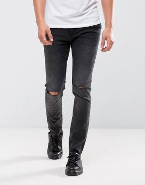 Cheap Monday Черные облегающие джинсы с рваными коленями. Цвет: черный