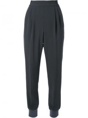 Tapered trousers Muveil. Цвет: зелёный