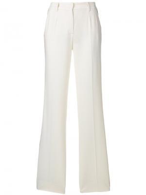 Расклешенные брюки с полосатыми панелями Dolce & Gabbana. Цвет: телесный