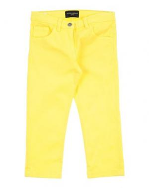 Джинсовые брюки DOLCE & GABBANA. Цвет: желтый