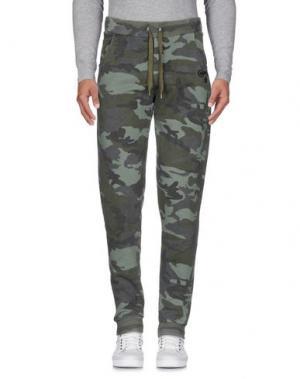 Повседневные брюки CONVERSE. Цвет: зеленый-милитари