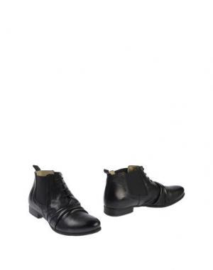 Полусапоги и высокие ботинки JOKER. Цвет: черный