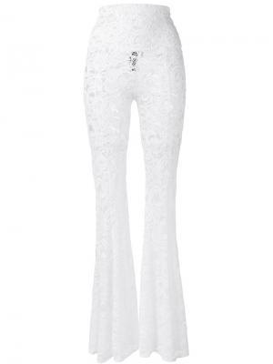 Расклешенные кружевные брюки Norma Kamali. Цвет: белый
