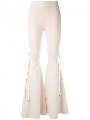 Расклешенные брюки Puma. Цвет: телесный
