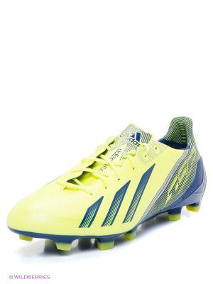 Бутсы adizero F50 Adidas. Цвет: салатовый