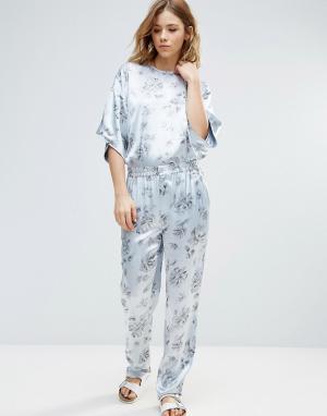 Ganni Атласные брюки с цветочным принтом Gold St.. Цвет: белый