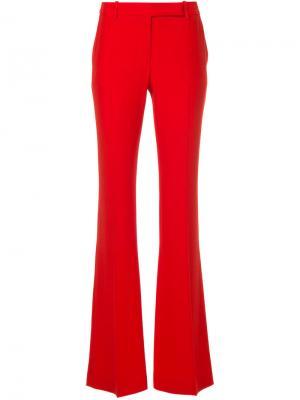 Расклешенные брюки Alexander McQueen. Цвет: красный
