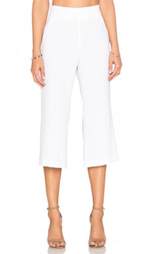 Укороченные расклёшенные брюки Enza Costa. Цвет: белый
