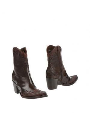 Полусапоги и высокие ботинки DONNA PIÙ. Цвет: темно-коричневый