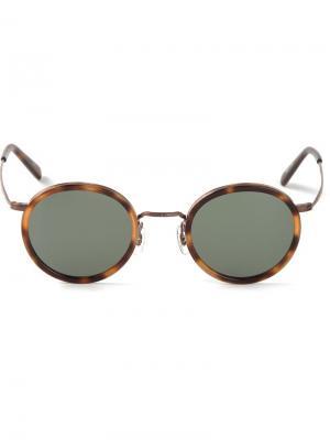 Солнцезащитные очки в круглой оправе Masunaga. Цвет: коричневый