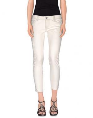 Джинсовые брюки CAROLINA WYSER. Цвет: слоновая кость