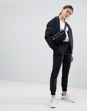 Tommy Jeans Джоггеры с фирменным поясом. Цвет: черный