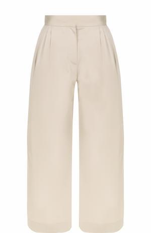 Укороченные широкие брюки с защипами The Row. Цвет: светло-бежевый