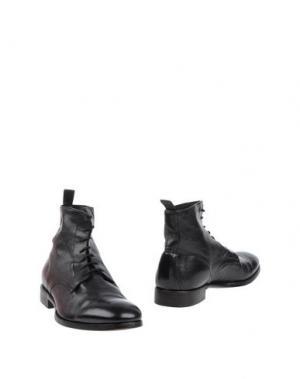 Полусапоги и высокие ботинки ROLANDO STURLINI. Цвет: черный