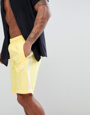Adidas Originals Желтые шорты для плавания adicolor CW1307. Цвет: желтый