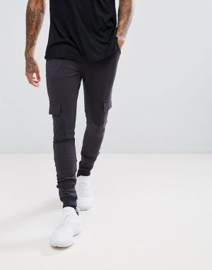 Troy Джоггеры с боковыми карманами. Цвет: темно-синий