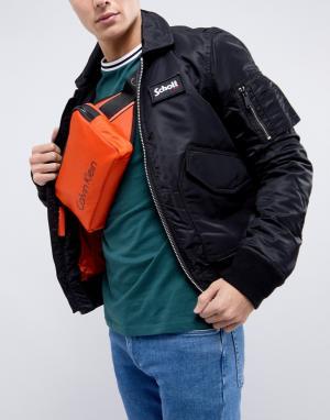 Calvin Klein Оранжевая сумка-кошелек на пояс Blithe. Цвет: оранжевый