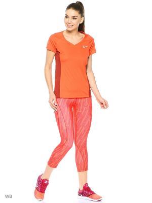 Леггинсы W NP HPRCL CPRI SKEW Nike. Цвет: оранжевый
